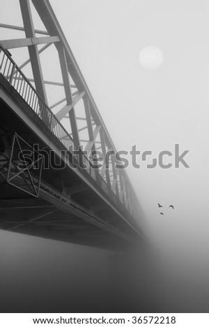 Bridge in the fog in black and white. - stock photo