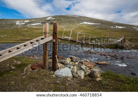 Bridge in the Norwegian national park Jotunheimen - stock photo