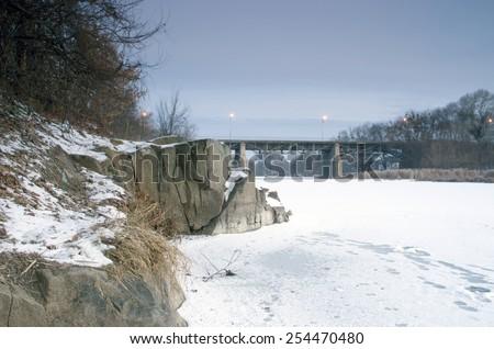bridge in winter Korostishev at morning - stock photo