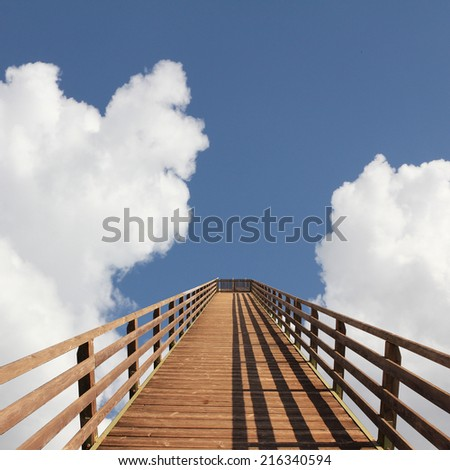 bridge into heaven, sky with dreamy clouds - stock photo