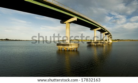 Bridge Leading to an island going across water - stock photo