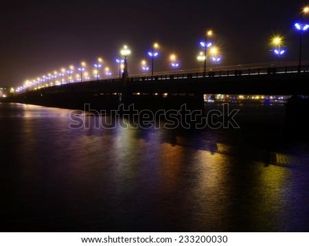 Bridge lights in fog in Riga, Latvia - stock photo