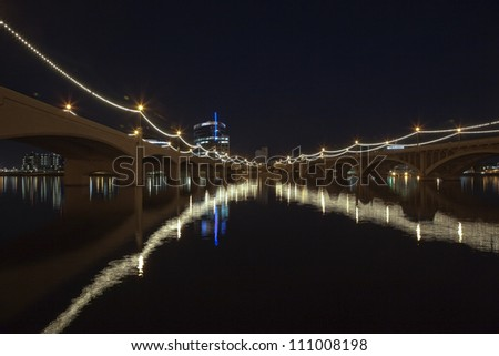 Bridge lights over the waters of the Tempe Town Lake - stock photo