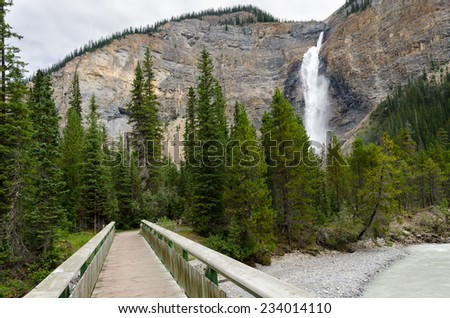 bridge near the Takakkaw waterfall in Banff in Canda - stock photo