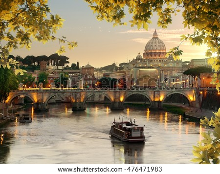 Bridge of Saint Angelo near Vatican in autumn at sunset