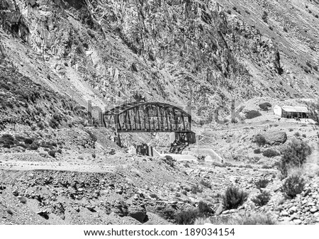 Bridge on Ferrocarril Trasandino. Aconcagua National Park. Aconcagua (6962 m) is the highest mountain in the Americas - Andes, Argentina (black and white)