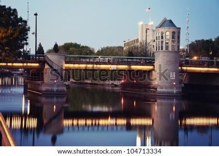 Bridge on Milwaukee River at sunset - stock photo