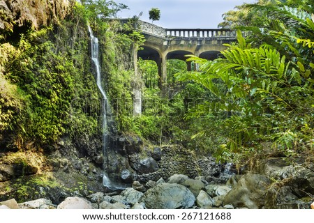 Bridge on the Hana Highway across the Wailua Nui Stream near the Upper Waikuni Falls on Maui Island in Hawaii. - stock photo