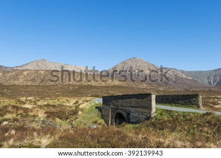 Bridge on the Isle of Skye with road and mountains in Scotland, image by Daan Kloeg, Commee