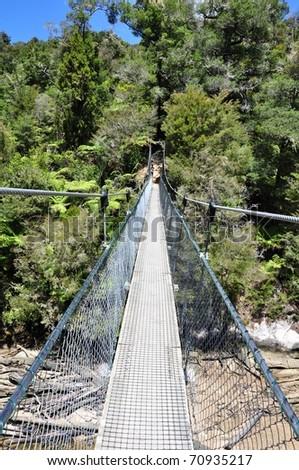 bridge on the river in abel tasman national park, new zealand - stock photo
