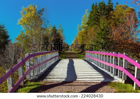 Bridge over a brook on the Confederation Trail in rural Prince Edward Island.  Also known as the Trans Canada Trail. - stock photo