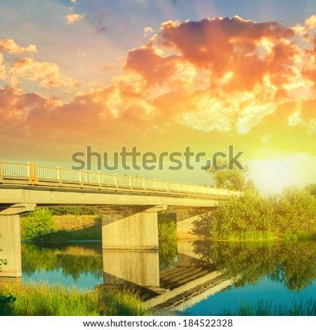 bridge over a river at the evening - stock photo