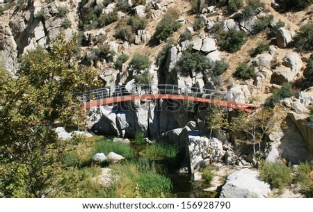 Bridge over a river in the mountains, California - stock photo