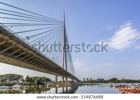 Bridge Over Ada, connecting right Sava river bank and old part of town with the left river bank and New Belgrade, with its pylon grounded on the lover pint of the river isle Ada Ciganlija.