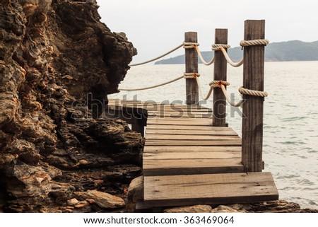 Bridge over coastline rock of Khao Laem Ya, RAYONG, THAILAND. - stock photo