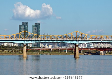 Bridge over river with a subway train in sunny afternoon