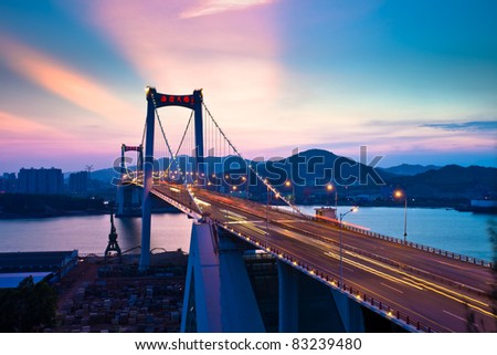 bridge over sea at night in xiamen - stock photo