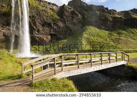 bridge over Seljalandsfoss waterfall in Iceland
