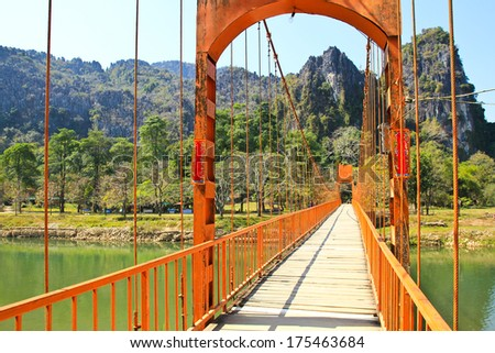 Bridge over Song River, Vang Vieng, Laos. - stock photo