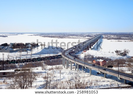 Bridge over the frozen river in winter