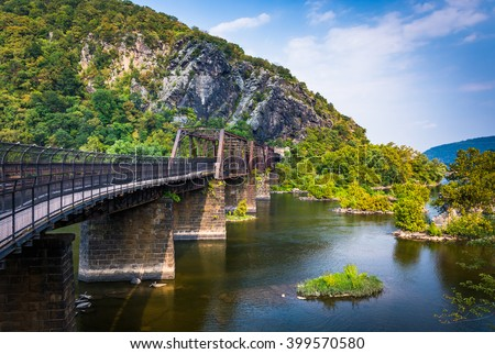 Bridge over the Potomac River and view of Maryland Heights, in Harper's Ferry, West Virginia. - stock photo