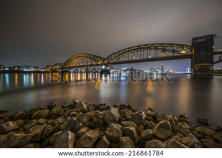 Bridge over the Rhine River by night, Cologne, Germany - stock photo