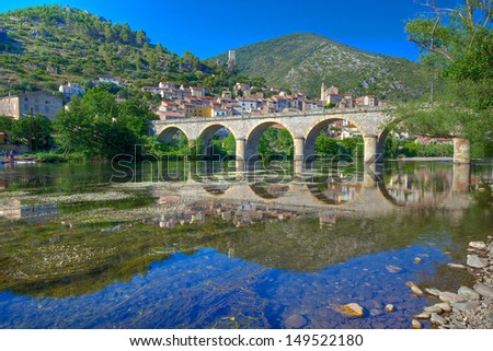 Bridge over the River Orb at Roquebrun - stock photo