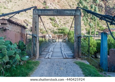 Bridge over |Urubamba river in Pichingoto village in Sacred Valley of Incas, Peru - stock photo