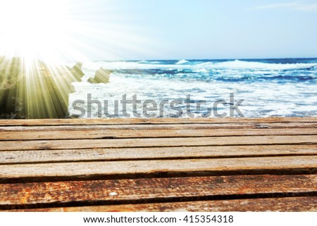 bridge pier on the beach - stock photo