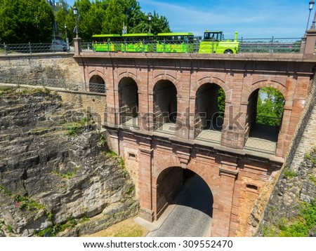 "Bridge ""Pont du Chateau"" and tourist train ""Petrusse Express"", Luxembourg - stock photo"