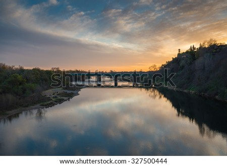 Bridge Spans River at Sunset in Sacramento - stock photo