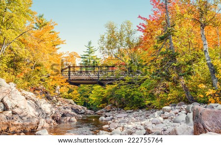 Bridge to Mary Ann Falls in the fall (Highlands National Park, Cape Breton, Nova Scotia, Canada) - stock photo