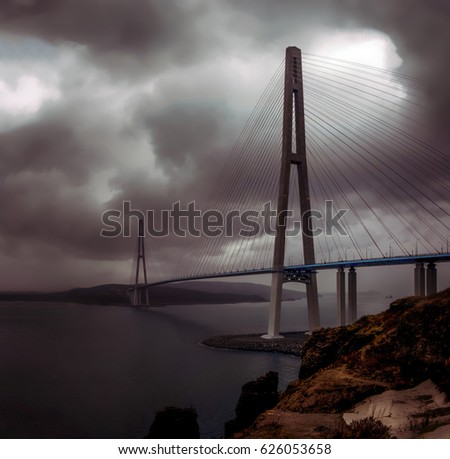 Bridge to the Russian island in Vladivostok at dusk in the storm and heavy rain