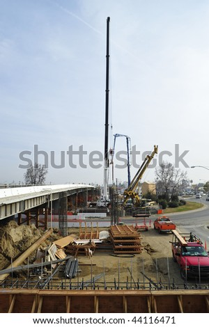 Bridge widening construction project: Concrete is pumped into reinforcing bar cage - stock photo