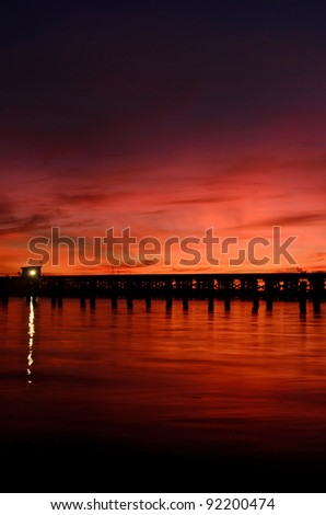 bridge with a control booth at sunrise - stock photo