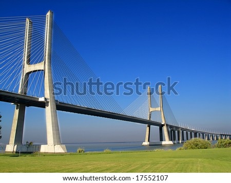 Bridge with green grass and blue sky