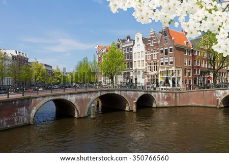 bridges  and houses of canal ring at spring day, old town of  Amsterdam, Netherlands Holland
