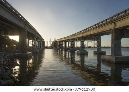 Bridges over River/Two Bridges/Sunset falls on two bridges at Meritt Island Florida  - stock photo