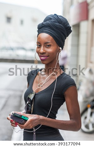 BRIDGETOWN, BARBADOS - MARCH 11, 2014: An Unidentified Beauty Girl in Bridgetown Street. Barbados. Caribbean Sea Island.