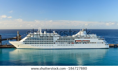 BRIDGETOWN, BARBADOS - NOVEMBER 8: Cruise ship Silver Whisper in Bridgetown on November 8, 2013.  Silver Whisper entered service in 2000 and is a luxury cruise ship operated by Silversea Cruises. - stock photo