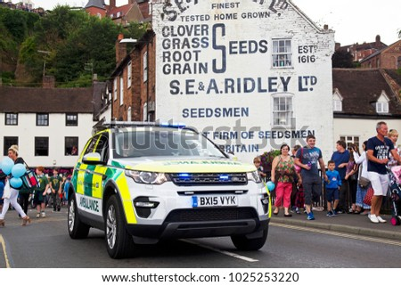 BRIDGNORTH, UK - JUNE 24: A first responder paramedic vehicle passes over the river Severn while participating in the annual Bridgnorth carnival on June 24, 2017 in Bridgnorth