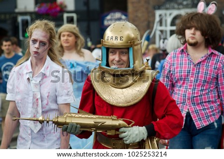 BRIDGNORTH, UK - JUNE 24: People dressed in comic character costumes walk along the carnival route collecting money for charity at the Bridgnorth carnival on June 24, 2017 in Bridgnorth
