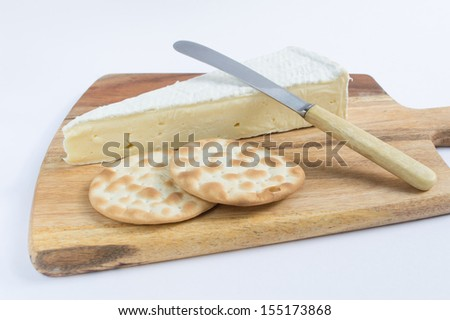 Brie and Crackers on a Wooden Board - stock photo
