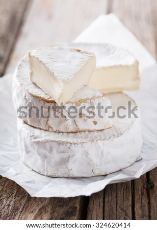 Brie, Camember cheese on a wooden Board.selective focus. - stock photo