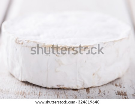 Brie,Camember cheese on white background.selective focus. - stock photo