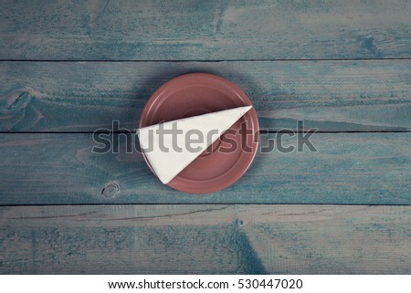 Brie cheese on wooden table. Top view