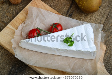 Brie cheese triangle with tomato and parsley