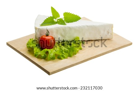 Brie cheese with thyme and salad leaves - stock photo