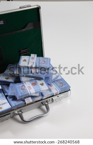 brief case full of dollar on white background - stock photo