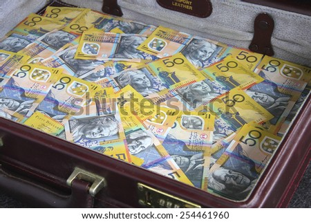 Briefcase full of Australian Fifty Dollar Notes - stock photo